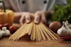 Chef preparing spaghetti Stock Image