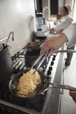 Chef Preparing Spaghetti In Kitchen Royalty Free Stock Photography