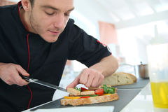Chef preparing a starter in restaurant Stock Image