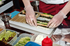 Chef preparing sushi Stock Images