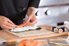 Chef preparing sushi Royalty Free Stock Image