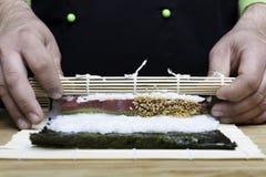 Chef preparing sushi royalty free stock photos