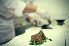 Chef preparing tenderloin Royalty Free Stock Photography