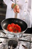 Chef preparing tomato Stock Photography