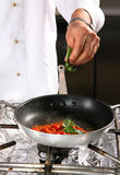 Chef preparing tomato Stock Photo
