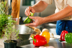 Chef preparing vegetables Stock Images
