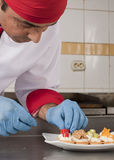 Chef prepearing canapes Stock Photos