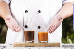Chef present Glass of Thai Tea and Coffee Stock Image