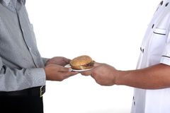 Chef present Hamburger to customer Royalty Free Stock Photo