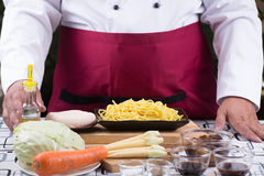 Chef present ingredient of stir fry vegetarian Noodle Royalty Free Stock Image