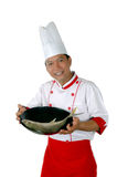 Chef present raw fish on a black frying. Isolated on white background Stock Photo