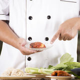 Chef present roasted chicken with noodle ingredient Royalty Free Stock Photography