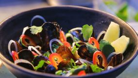 Chef presentation of delicious mussels in craft wooden bowl seafood restaurant dish - Japanese or Asian food stock video