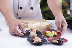 Chef presented Chinese Dim Sum Royalty Free Stock Images