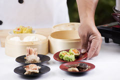 Chef presented Chinese Dim Sum / Cooking Dim sum concept Stock Images