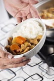 Chef presented Japanese pork curry with steam rice Royalty Free Stock Photography