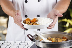 Chef presented Japanese pork curry with steam rice Royalty Free Stock Image