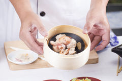 Chef presented steam mince pork and sausage Chinese Dim Sum Royalty Free Stock Photography