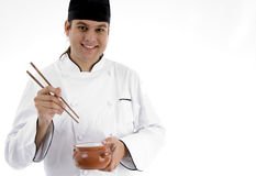 Chef presenting chinese dish with chopstick Royalty Free Stock Image