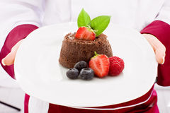 Chef presenting Chocolate cake with strawberries Royalty Free Stock Images