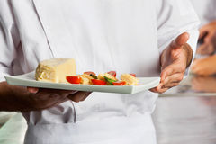 Chef Presenting Dish Stock Image