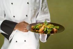 Chef Presenting Healthy Chicken Salad. Close-Up of Chef Presenting Plate with Healthy Chicken Salad Stock Photos