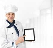 Chef presenting menu. On a tablet computer Stock Photo