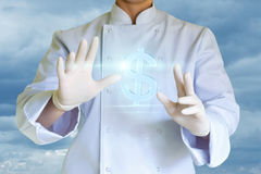 The chef presents a symbol dollar. Stock Images