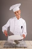 Chef Presents White Plate Royalty Free Stock Image
