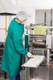 Chef Processing Ravioli Pasta In Machine Stock Photography