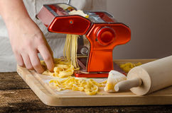Chef production pasta - Italian pasta grinder Stock Photography