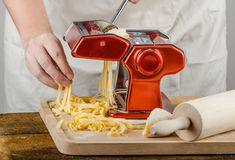 Chef production pasta - Italian pasta grinder Royalty Free Stock Images