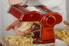 Chef production pasta - Italian pasta grinder Stock Photos