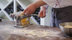 Chef production pasta - Italian pasta grinder, wood board, rolling-pin, all made from semolina flour stock footage