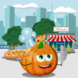 Chef pumpkin holding pizza with attitude in front of a restaurant Stock Images