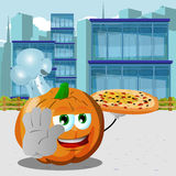Chef pumpkin with pizza holding a stop sign in the city Royalty Free Stock Images