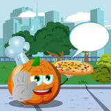 Chef pumpkin with pizza holding a stop sign in the city park with speech bubble Royalty Free Stock Image