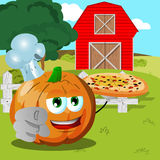 Chef pumpkin with pizza pointing at viewer on a farm Royalty Free Stock Photos