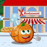 Chef pumpkin with pizza showing thumb up in front of a restaurant Royalty Free Stock Images