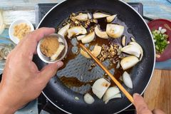Chef put dashi powder for cooking beef with rice Stock Photos