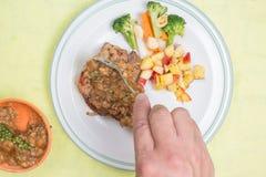 Chef puted gravy sauce to pork chop steak Royalty Free Stock Image
