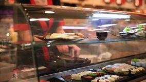 Chef puts the dishes for sale in Japanese shop stock footage