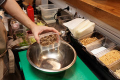 Chef is putting buckwheat noodles in a bowl Royalty Free Stock Photos