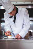Chef putting finishing touch on dessert Stock Photography
