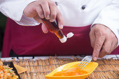 Chef putting fish sauce to egg Stock Photo