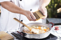 Chef putting Japanese curry paste for cooking Stock Photos