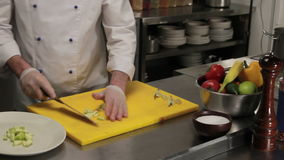 Chef putting sliced apple on a plate, medium shot stock footage