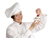 Chef Putting Strawberry on Top Royalty Free Stock Photography