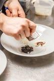 Chef rasping lemon zest Stock Images