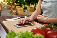 Chef reading the recipe on your smartphone Stock Image